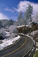 Spring storm dusts the hills and road near the top of Mount Hamilton, Santa Clara County, California