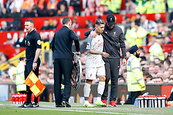Liverpool's Roberto Firmino (second right) is hugged by Liverpool manager Jurgen Klopp after coming off injured during the Premier League match at Old Trafford, Manchester.