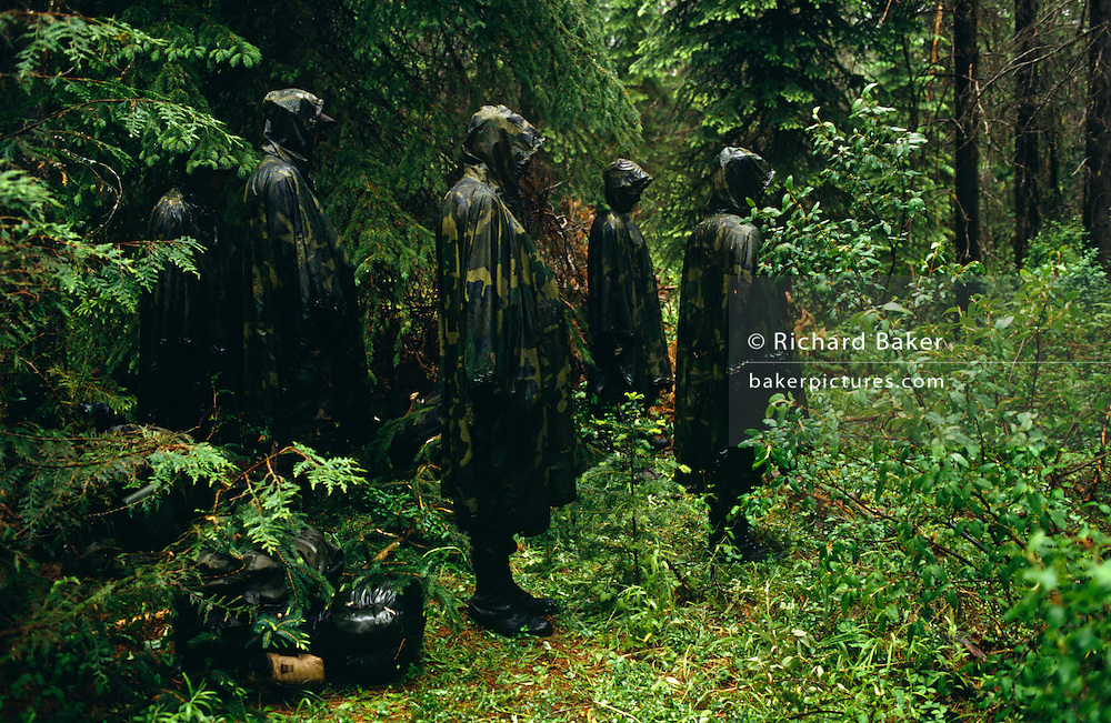 In pouring rain, United States Air Force pilots stand like canmouflaged statues in the undergrowth near Fairchild Air Force Base, Spokane, Washington. They are listening to a USAF survival instructor giving them advice about another challenge they are about to face, a few hundred yards ahead in the woods, so they listen intently in the saturatedconditions. They stand motionless, green figures in a green maze of foliage, wearing waterproof cagoules covering their backpacks which are shiny as the rain trickles down. They look like hunchbacks of the forest. The week-long survival course is held at the military facilities around Fairchild where the Air Force conducts a survival, escape and evasion course which combat pilots need to pass before rejoining their units for real-time warfare. This part of the lecture is held in the forest and forms part of an extensive physical and psychological assessment for young aviators on active service. In the future any one of them may be shot down behind enemy lines and need to use the lessons passed-on here to help facilitate their rescue by US forces. One pilot who passed this course in 1991, himself a Spokane-born boy, was F-16 pilot Scott O'Grady. He put his skills learned here to the test while evading Serb forces before being airlifted to safety and a hero's Presidential welcome.