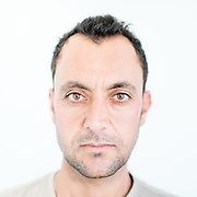 Qawal Kheder Saydo a 30 year old Yazidi from Rambusi, northern Iraq. <br /> <br /> This is a series of portraits of Yazidi refugees who were stranded since April 2016 in Greece.  All of them survived the Yazidi Genocide by ISIS in August 2014 and most of them have lost family members.