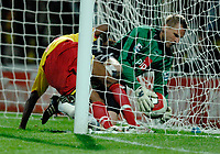 Photo: Richard Lane.<br />Watford v Fulham. The Barclays Premiership. 02/10/2006. <br />Watford's Ashley Young puts the ball into the net for a goal as Fulham keeper, Antti Niemi fails to save.