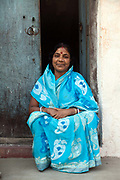 A women outside her house in the the old colonial town of Chandannagar, India