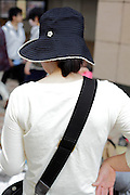 woman with shoulder bag and hat