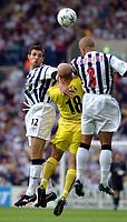 Fotball. Premier League. 24.08.2002.<br /> West Bromwich Albion v Leeds 1-3.<br /> Danny Mills, Leeds United.<br /> Scot Dobie og Neil Clement, WBA.<br /> Foto: Matthew Impey, Digitalsport