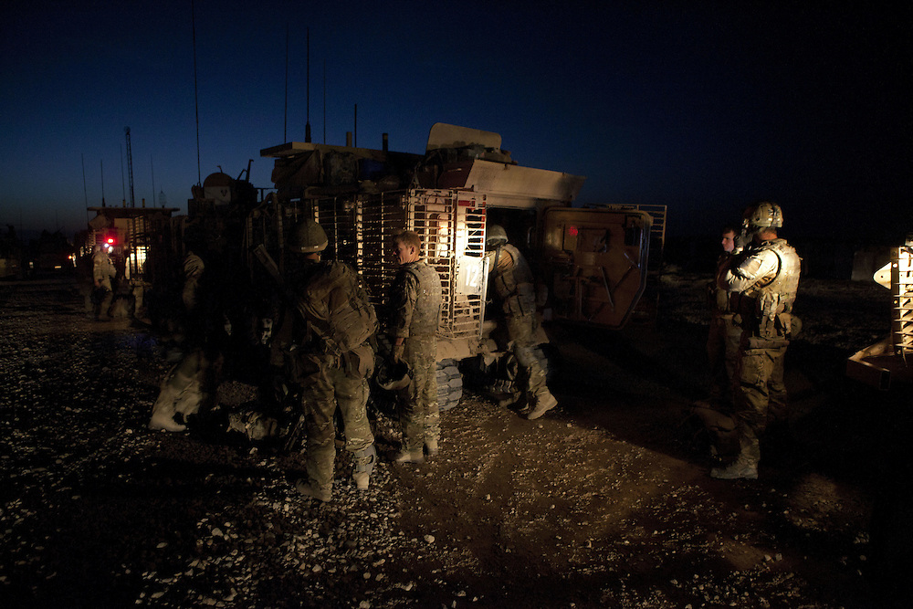British soldiers of 16 Air Assault Bde's elite BRF (Brigade Reconnaissance Force) make final preparations in the early hours of the morning ready to head out on an operation in the village of Kakaran in Helmand Province, Southern Afghanistan on the 14th of March 2011.