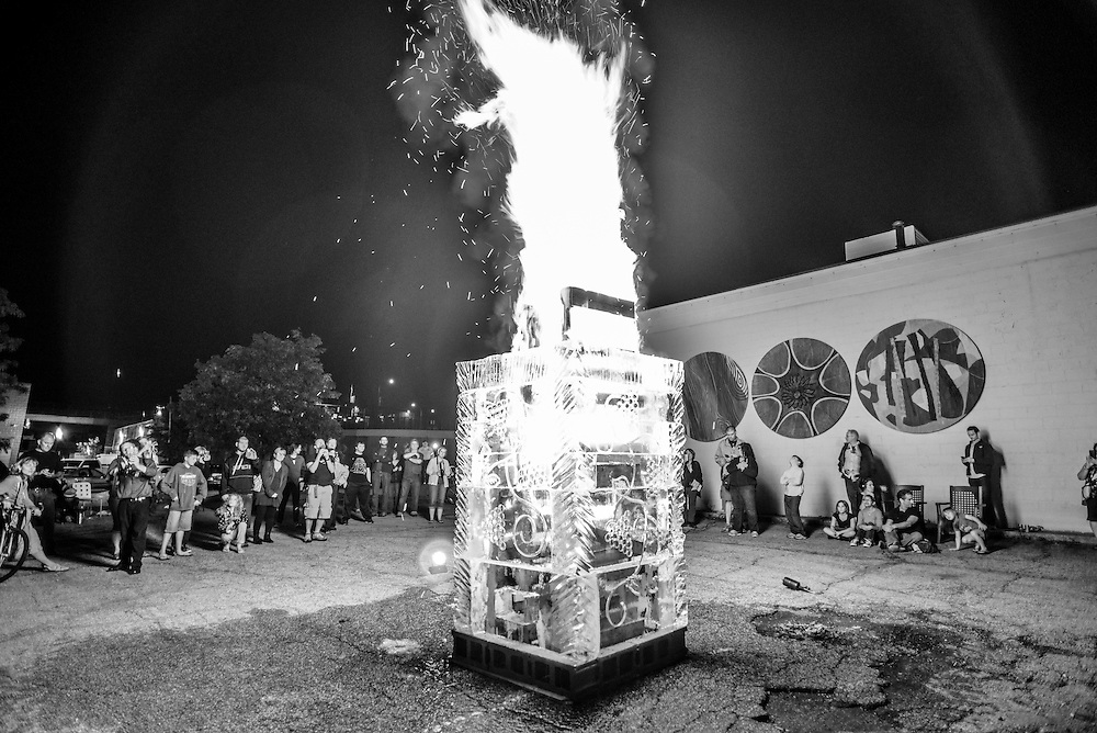 Crowd gathered around the lit Fire and Ice Tower at the NorthSide district during Akron Art Prize 2014.