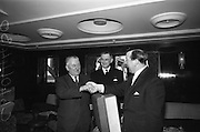 "06/04/1966<br /> 04/06/1966<br /> 06 April 1966<br /> Captain John Williams retires as Master of B & I ship the M.V. ""Munster"". Captain Williams was presented with a tape recorder by the Masters, Officers and staff of all the B & I ships. Picture shows Captain Gerald Barry, (right)Master of the M.V. ""Leinster"" making the presentation to Captain Williams. Captain Matthew Hollywood (centre) was the new Master of the M.V. ""Munster""."