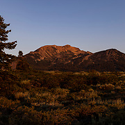 The Eastern Sierras glow in the warmth of a summer sunrise in Mammoth Lakes, CA.