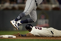 September 13, 2017 - Minneapolis, MN, USA - The Minnesota Twins' Eddie Rosario safely slides into third base and scores on an overthrown ball by catcher Austin Hedges in the second inning on Wednesday, Sept. 13, 2017, at Target Field in Minneapolis. (Credit Image: © Carlos Gonzalez/TNS via ZUMA Wire)
