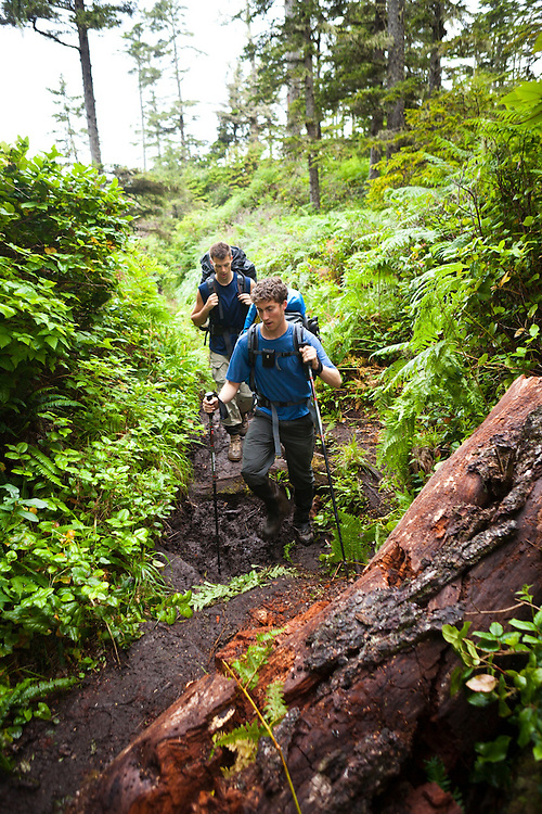 Zach Podell-Eberhardt (front) and Henry tackle a section of muddy trail on the West Coast Trail, British Columbia, Canada.