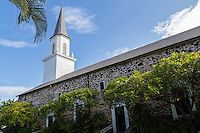 Mokuaikaua Church is in Kailua-Kona, Hawaii. Its steeple has become a Kona icon and landmark.  It was build of lava and coral and completed in 1837.  The church represents western architecture of early 19th century in Hawaii.  Mokuaikaua takes its name from a forest above Kona from which timbers were cut and dragged overland to construct the ceiling and interior.  Mokuaikaua Church has been added to the National Register of Historic Places.