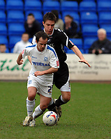 Photo: Paul Greenwood.<br />Tranmere Rovers v Swansea City. Coca Cola League 1. 10/03/2007.<br />Tranmere's Chris Shuker (L) shields the ball from Pawel Abbott