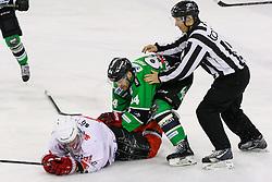 Fight between Andrej Hebar of Olimpija and Saso Rajsar of Jesenice during ice hockey game between HDD Telemach Olimpija and SIJ Acroni Jesenice in 3rd leg of Finals of Slovenian National Championship 2015, on April 13, 2015 in Hala Tivoli, Ljubljana, Slovenia. Photo by Matic Klansek Velej / Sportida
