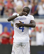 JACKSONVILLE, FL - JUNE 07:  Forward Jozy Altidore #17 of the United States shoots is congratulated by teammate and midfielder Michael Bradley #4 after Altidore's second goal of the game during the international friendly match against Nigeria at EverBank Field on June 7, 2014 in Jacksonville, Florida.  (Photo by Mike Zarrilli/Getty Images)