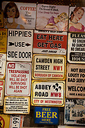 Old signs for sale at Camden Market, North London. Camden Lock is a crowded hang out for young Londoners.