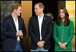Image ©Licensed to i-Images Picture Agency. 05/07/2014. Yorkshire, United Kingdom. The Royals attend the Tour De France -Yorkshire. The Duke and Duchess of Cambridge and Prince Harry at  the Stage One finish line at Harrogate. They are watching  the cyclists cross the finish line in an expected sprint finish, before presenting the awards to the Stage One winners. Picture by Andrew Parsons / i-images