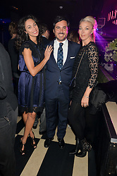Left to right, LILLY BECKER, EDUARDO SANCHEZ and TAMARA BECKWITH at a party to celebrate the 1st anniversary of Hello! Fashion Monthly magazine held at Charlie, 15 Berkeley Street, London on 14th October 2015.
