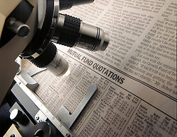 microscope looking at Wall Street Journal