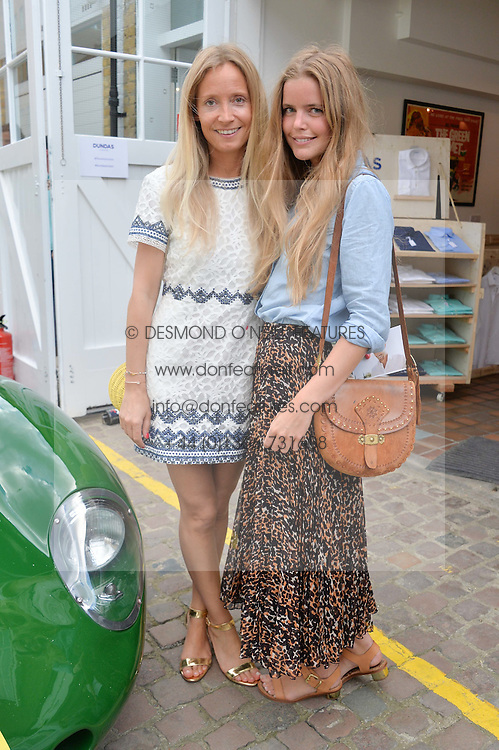 Left to right, MARTHA WARD and KATIE READMAN at the launch of Dundas London held at Fiskins Classic Car Showroom, 14 Queens Gate Place Mews, London on 25th June 2014.