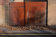 Rusting metal gates, locked and secure on a street, on 28th November 2016, near Camberwell, south London borough of Southwark, England.