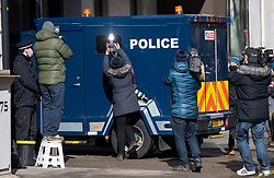 © Licensed to London News Pictures. 13/03/2021. London, UK.  Media and police surround a heavily armoured police vehicle carrying a prisoner in to Westminster Magistrates Court where murder suspect Wayne Couzens is due to appear. Couzens, A serving Met Police officer, has been charged with with the kidnap and murder of Sarah Everard, who disappeared as she walked home in Clapham, south London. The body of Sarah Everard was later discovered woodland in Kent more than a week after she was last spotted on 3 March. Photo credit: Ben Cawthra/LNP