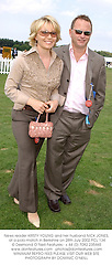 News reader KIRSTY YOUNG and her husband NICK JONES, at a polo match in Berkshire on 28th July 2002.PCL 134