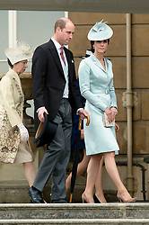 The Duke and Duchess of Cambridge during a garden party at Buckingham Palace in London.