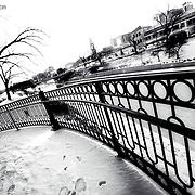 Kansas City Plaza Lights - close up view of decorative iron fence along pedestrian bridge over Brush Creek.