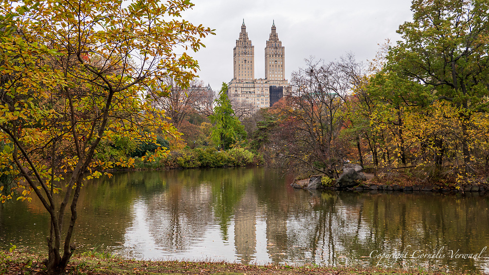 Autumn colors at The Lake in Central Park with a view of the San Remo apartment towers