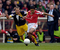 Photo: Jed Wee.<br />Nottingham Forest v Weymouth. The FA Cup.<br />05/11/2005.<br />Forest's Jack Lester (R) and Weymouth's Andrew Harris challenge for possession.