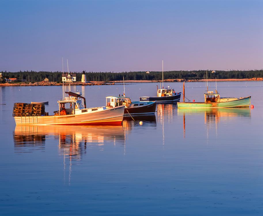 Fishing boats & Prospect Harbor Light in distance, late pm light, Prospect Harbor, ME