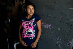 """Sulmi, 14, who 9 months pregnant with a girl, at her home. """"I studied in school but I left after 3rd grade. I met my husband when we were both working in another city. He's always worked by making leather products and I worked selling what he made. We were married almost a year ago."""""""