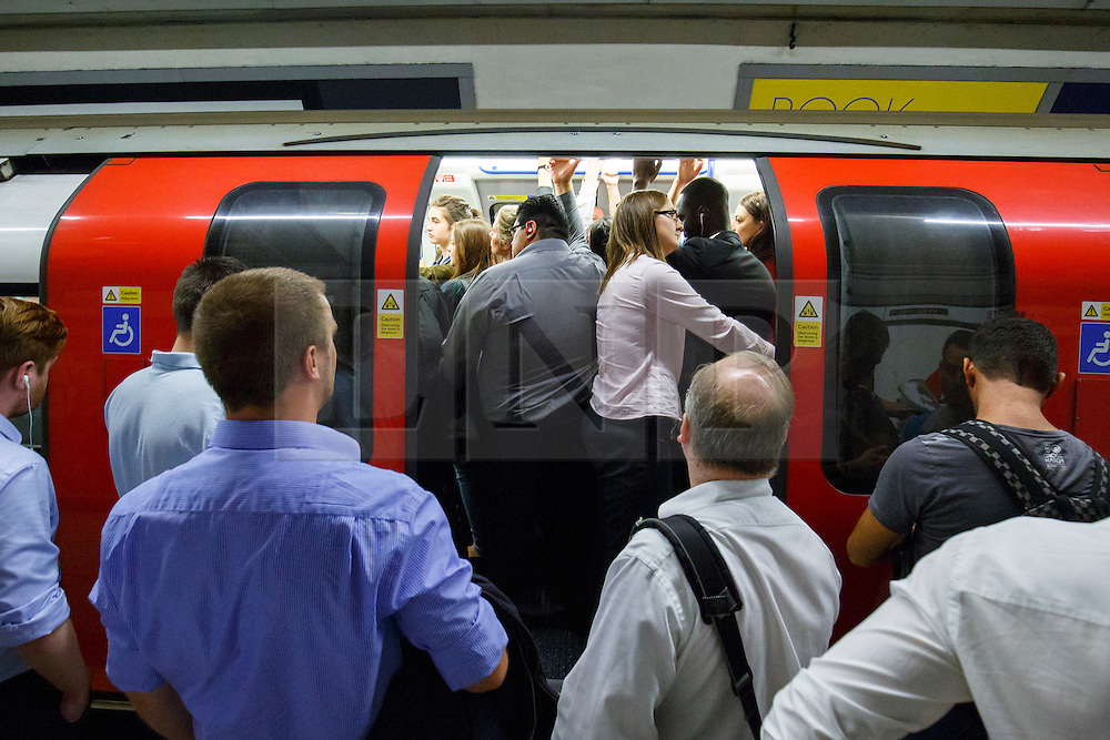 © Licensed to London News Pictures. 05/08/2015. London, UK. Commuters queuing for tube trains at Moorgate tube station ahead of the Tube strike in the evening rush hour of Wednesday, August 5, 2015. The strike will be a 27-hour stoppage by about 20,000 Tube staff to shut down the entire London Underground network on the second strike over night `service on parts of Tube, which will be starting on 12 September 2015. Photo credit: Tolga Akmen/LNP
