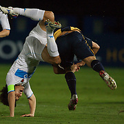 Pohang Steelers defender Jae Won Hwang goes over the top of  Nik Mrdja  during the group H group stage match between the Central Coast Mariners of Australia and Pohang Steelers of Korea in Gosford, Australia on March 11 2009, The match ended in a 0-0 draw. Photo Tim Clayton