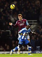 Photo: Chris Ratcliffe.<br />West Ham United v Wigan Athletic. The Barclays Premiership. 28/12/2005.<br />James Collins (L) of West Ham rises above Henri Camara.