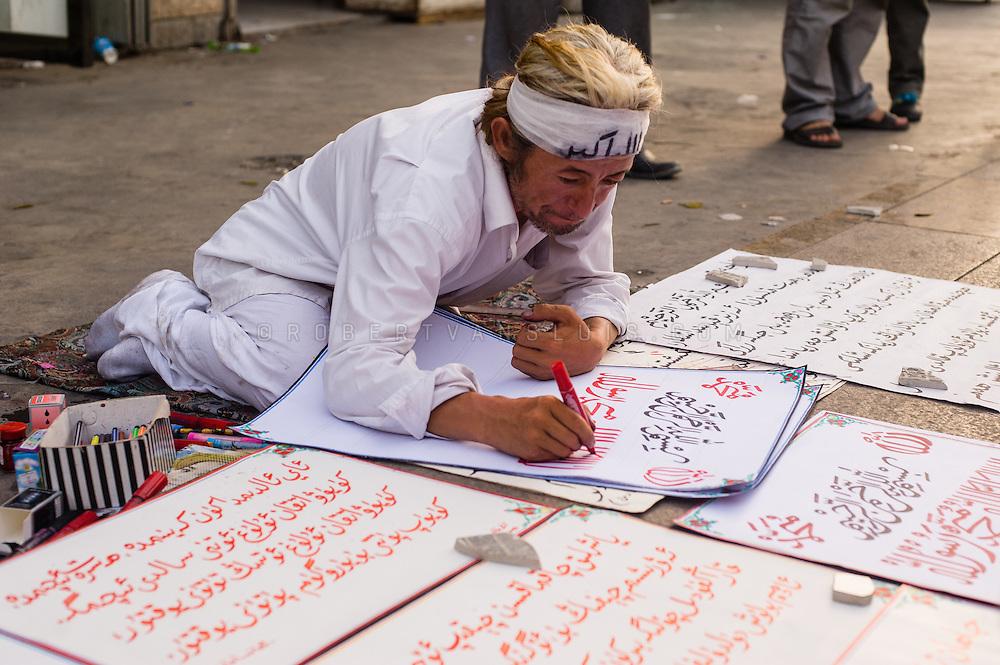 Religious calligrapher, Turpan, Xinjiang, China