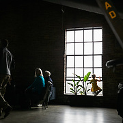 RALEIGH, NC - FEBRUARY 23: A small child plays on the inside ledge of the large industrial windows at Transfer Co. Food Hall  on February 23, 2019 in Raleigh, NC. (Logan Cyrus for The New York Times)