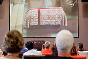 23 JULY 2009 -- PHOENIX, AZ: People look at Walter Cronkite's casket. About 35 people gathered at ASU's Cronkite School Thursday to watch the live feed of the funeral of the school's namesake. Legenday CBS anchor Walter Cronkite died Friday, July 17.    PHOTO BY JACK KURTZ