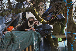 © Licensed to London News Pictures. 28/01/2021. London, UK. HS2 Rebellion protestors remain camped in a tree above Euston Square Gardens. Protestors are resisting a police operation to remove them for a second day. It is reported the protesters have built a 100ft tunnel under the gardens. Photo credit: Peter Macdiarmid/LNP