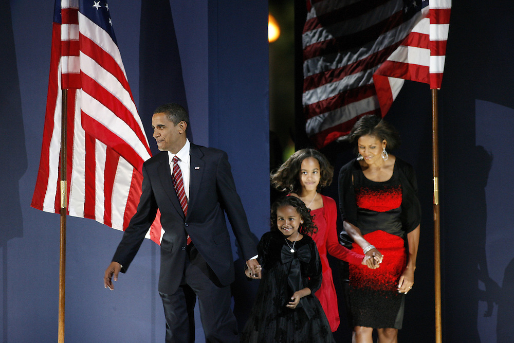 Barack Obama enters the stage with wife Michelle and daughters Sasha and Malia to give a victory speech after being elected President of the United States before an enormous crowd in Grant Park in Chicago Tuesday night.