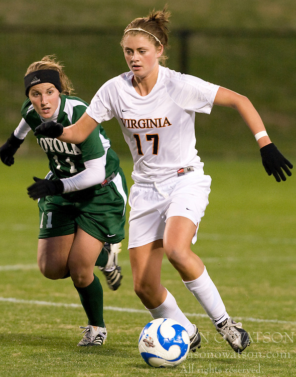 Virginia midfielder/forward Sinead Farrelly (17) dribbles past Loyola defender Brynn McGrath (11).  The Virginia Cavaliers defeated the Loyola (MD) Greyhounds 4-1 in the first round of the NCAA Women's Soccer tournament held at Klockner Stadium in Charlottesville, VA on November 16, 2007.