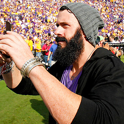 November 25, 2011; Baton Rouge, LA, USA; San Francisco Giants pitcher Brian Wilson a former member of the LSU Tigers baseball team takes a picture from the sideline prior to kickoff of a game against the Arkansas Razorbacks at Tiger Stadium. LSU defeated Arkansas 41-17. Mandatory Credit: Derick E. Hingle-US PRESSWIRE
