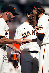 San Francisco Giants manager Gabe Kapler (19) takes the ball from starting pitcher Kevin Gausman (34) at the start of the eighth inning of a baseball game, Saturday, Oct. 2, 2021, in San Francisco. (AP Photo/D. Ross Cameron)