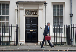 © Licensed to London News Pictures. 22/11/2017. London, UK. Chancellor of the Exchequer Philip Hammond leaves Number 11 Downing Street for Parliament on budget day. Photo credit: Peter Macdiarmid/LNP