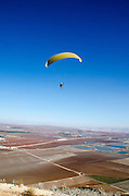 paragliding on blue sky background