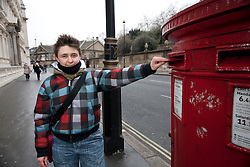 """© licensed to London News Pictures. London, UK 12/02/2012. Gay rights campaigner and Pride London's manager Martine Whitaker posting her Valentine's Day card to Buckingham Palace calling on the Queen to help """"kiss goodbye to homophobia"""" in some Commonwealth countries. Photo credit: Tolga Akmen/LNP"""