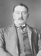 Cecil John Rhodes PC (5 July 1853 – 26 March 1902) was a British mining magnate and politician in southern Africa who served as Prime Minister of the Cape Colony from 1890 to 1896. An ardent believer in British imperialism, Rhodes and his British South Africa Company founded the southern African territory of Rhodesia (now Zimbabwe and Zambia), which the company named after him in 1895. South Africa's Rhodes University is also named after him. Rhodes set up the provisions of the Rhodes Scholarship, which is funded by his estate. He also put much effort towards his vision of a Cape to Cairo Railway through British territory.[