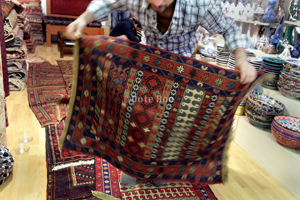 carpet seller displaying his carpets Istanbul