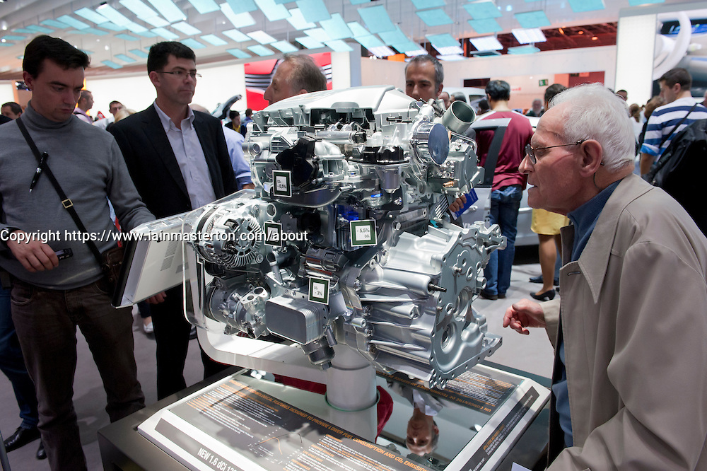 Visitors viewing Renault engine at Paris Motor Show 2010
