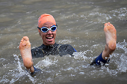 © Licensed to London News Pictures. 31/08/2018. LONDON, UK.  A participant at the start of the Thames River Swim as part of Totally Thames 2018.  Swimmers set off on a circular route from Hammersmith and around Chiswick Eyot, approximately 1500m.  Photo credit: Stephen Chung/LNP